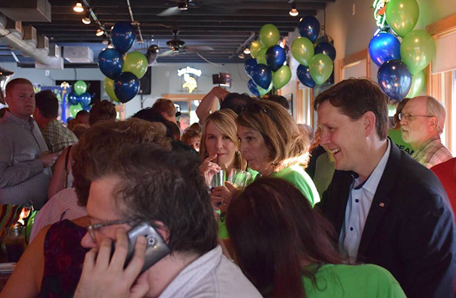Matt Dean, far right, greeting supporters at his campaign kick-off in July.