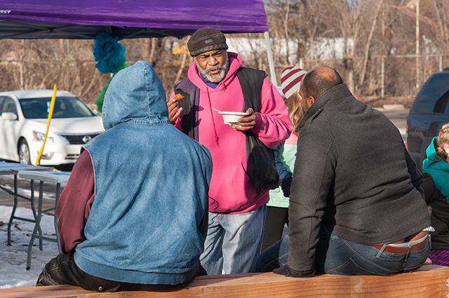 Friendly Street organizer Melvin Giles greets Rondo neighbors