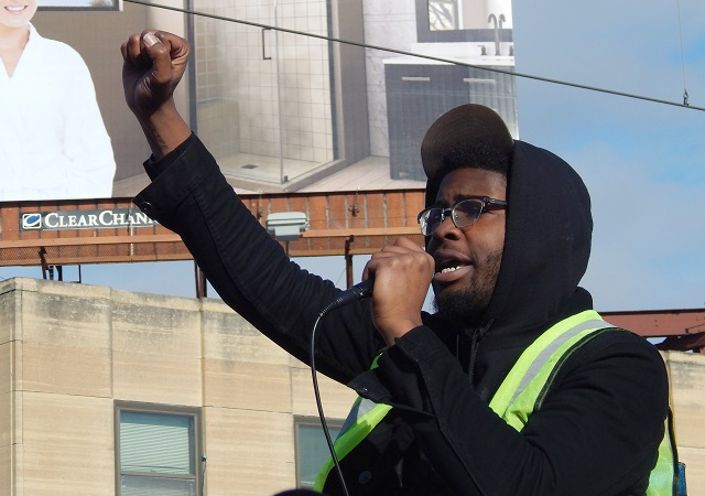 Black Lives Matter organizer Michael McDowell delivering a speech