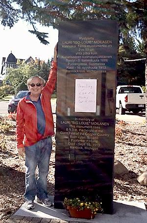 Robert Moilanen next to the Big Louie Moilanen monument.