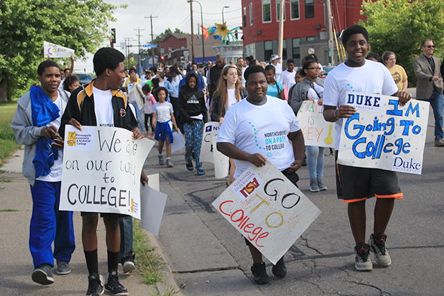 Youth heading down Penn Ave. N. at the start of the 3.7-mile walk