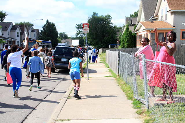Northside residents cheering on the walkers