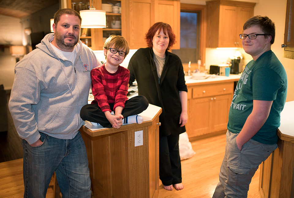 Nate Berg at home with his wife, Jen, with sons Drew and Chandler.