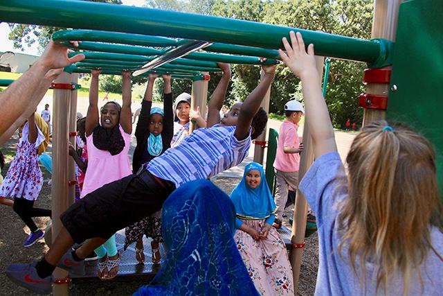 Children climbing on playground equipment