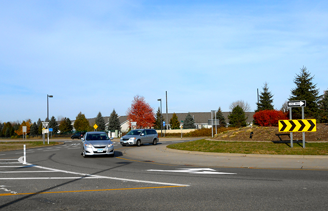 A roundabout at the intersection of Radio Drive and Bailey Road in Woodbury.