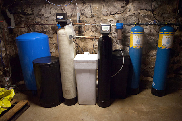 The water filtering system in the basement of Doug and Dawn Reeves' home