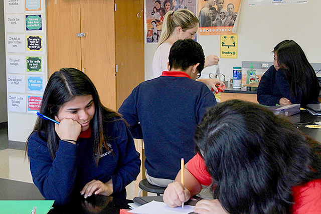 Eighth graders in science class at Risen Christ Catholic School.