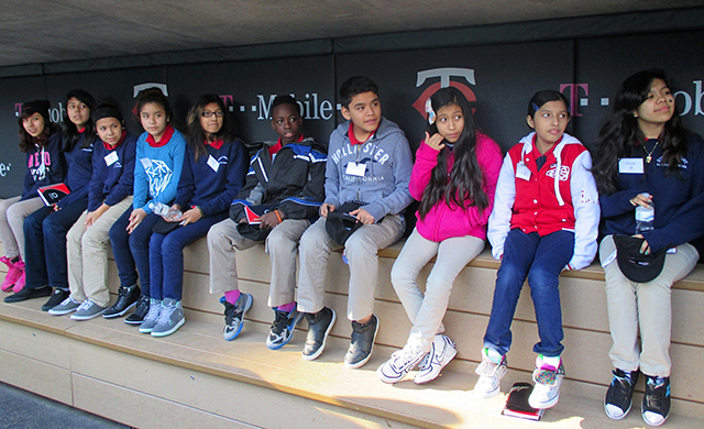 Students checking out the heated seats in the visitors' dugout