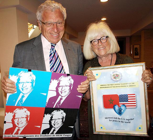 Sam and Sylvia Kaplan displaying artwork from students