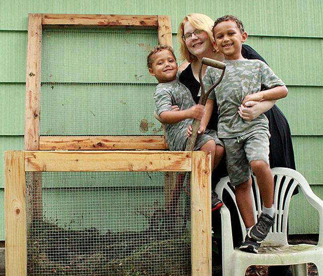 Sheri Selton, center, holding her sons, Joseph,left, and Prince Jr., right,