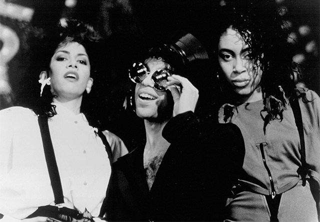 "Sheila E., Prince, and Cat in a scene from ""Sign 'o' the Times."""