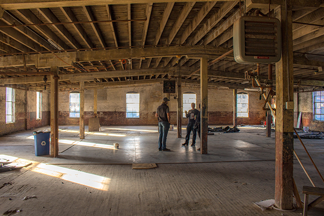 Bill Mague, right, showing visitors around the Soap Factory's third floor