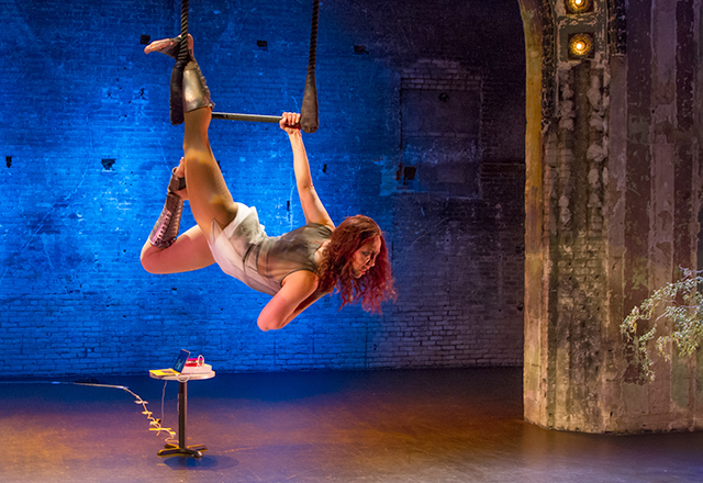 Katie Kimball performing an elegant dance on a trapeze