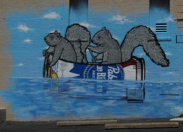 Squirrel beer can canoe mural