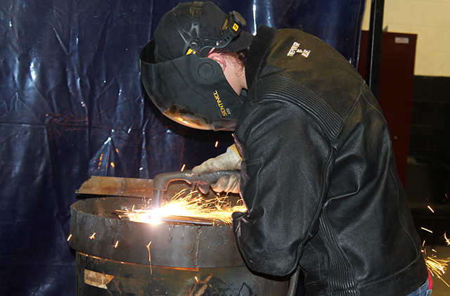 St. Paul College welding student
