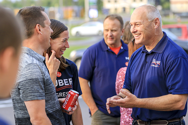 Pete Stauber, right, talking with Kyle and Ann Anderson of Pike Lake