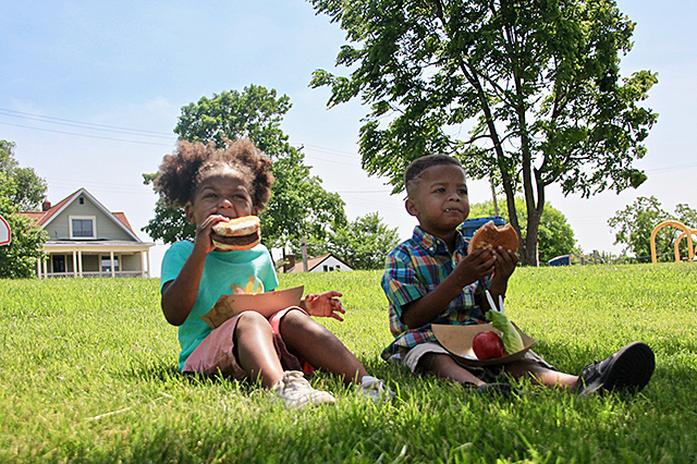Haiden and Shawn enjoying a burger from the Street Eats food truck.