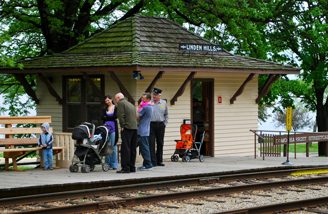 Passengers wait to board at the Linden Hills station