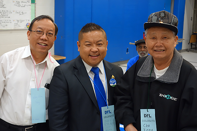 Dai Thao, center, won 14 delegates from his current Ward 1.