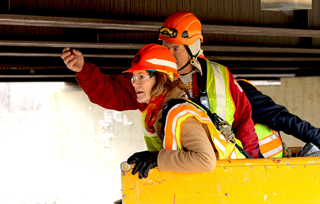 Lt. Gov. Tina Smith taking part in a MnDOT Bridge Inspection in Rochester