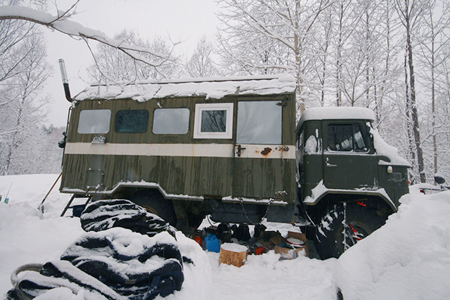 The two-room apartment on the Russian GAZ-66 flatbed truck, with wood stove.