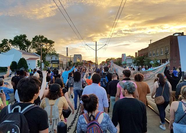 Demonstrators marching on the light rail tracks on University Avenue.