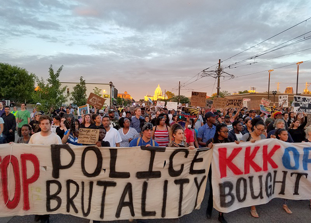 Demonstrators marched down University Avenue in St. Paul Friday night