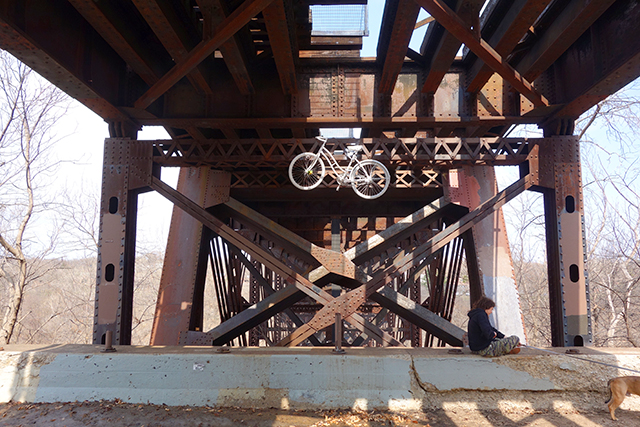 A ghost bike hangs from the superstructure of the Short Line Bridge