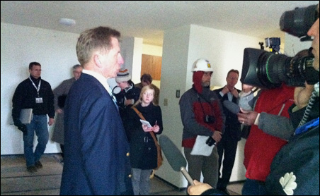 Developer George Sherman leads a tour of a renovated Riverside apartment.