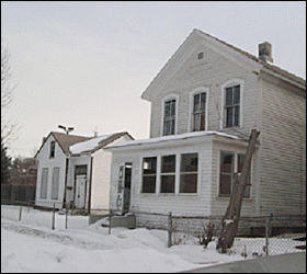 These two vacant houses are among three on a single block.