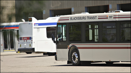 A bus manufactured for Blacksburg Transit in southwest Virginia, foreground, and another built for Philadelphia's SEPTA system sit in New Flyer's lot in St. Cloud.