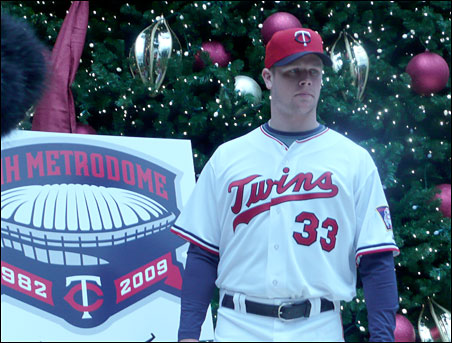 Justin Morneau models the 1982 throwback uniform that will be worn in 2009, the Twins final season at the Dome.