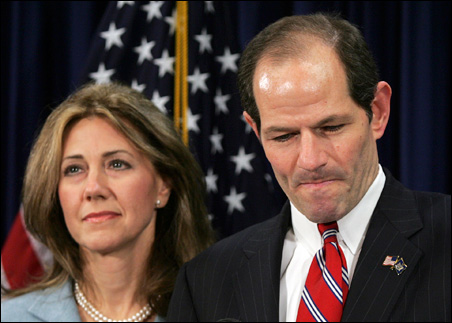New York Gov. Eliot Spitzer addresses the media with his wife, Silda Wall Spitzer, at his office Monday.