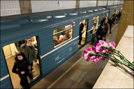 Flowers, left in memory of the victims of a bomb explosion, are seen at the Park Kultury metro station in Moscow on Monday.