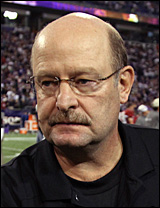 Brad Childress walks off the field following Sunday's game.