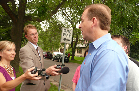DFL gubernatorial candidate Matt Entenza meets with the press after voting early today.