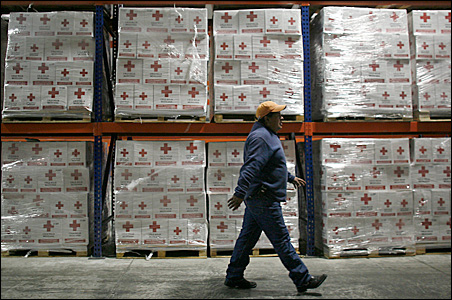 A Red Cross worker walks past humanitarian aid boxes, that will be sent to Haiti, at the Red Cross Center in Toluca.