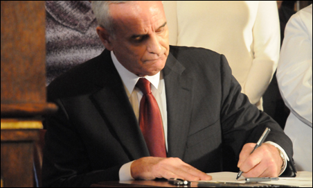 Gov. Mark Dayton made it official today, signing up for expanded federal medical assistance.