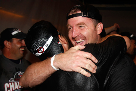 Twins designated hitter Jim Thome celebrates after the Twins clinched the AL Central title Tuesday night.