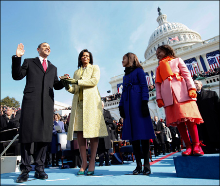 President Barack Obama takes the oath of office, flanked by his family.