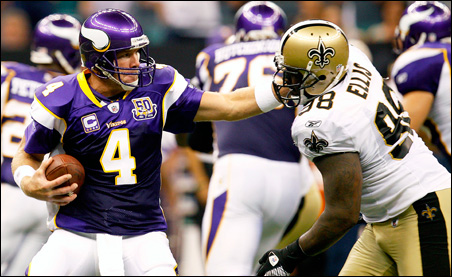 Brett Farve is sacked by New Orleans Saints defensive tackle Sedrick Ellis during the third quarter.