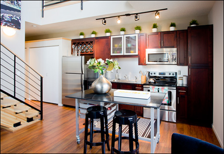The apartments feature high ceilings and upscale finishes.
