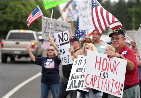 Tea Party activists like these in Flagstaff, Ariz., oppose higher taxes, but in fact fewer and fewer of us actually pay income taxes.