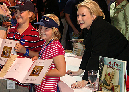 """Young fans and author Meghan McCain show off """"My Dad, John McCain."""""""