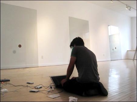 Abinadi Meza mixing sound in Weinstein Gallery for Delay in Glass installation.