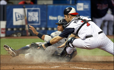 Catcher Joe Mauer (shown in the Twins' June 2 victory over the Yankees) considers calling a good game and hitting for average more important to the team's success than home run power.