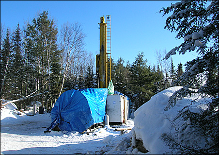 A prospecting drill in a forest about 10 miles south of Ely, Minn.