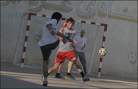 Gazans playing a game of soccer.