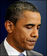 Obama pauses while delivering remarks on the debt ceiling crisis.