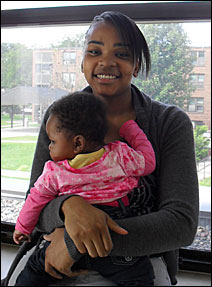 About to start classes at the Hubert H. Humphrey Job Corps, Brittany Mackie, 21, may live on campus with her baby daughter Londynn in a dorm for moms and their kids.